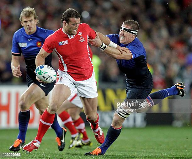 Jamie Roberts is tackled by Imanol Harinordoquy of France during semi final one of the 2011 IRB Rugby World Cup between Wales and France at Eden Park...