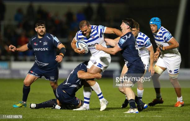 Jamie Roberts of Bath Rugby is tackled by Ben Curry and Josh Beaumont of Sale Sharks during the Gallagher Premiership Rugby match between Sale Sharks...