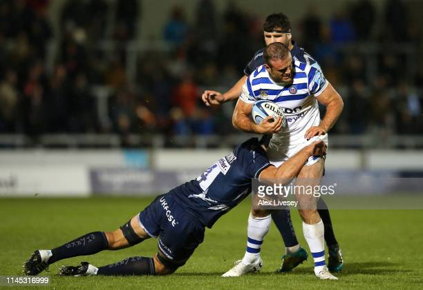 Jamie Roberts of Bath Rugby is tackled by Josh Beaumont of Sale Sharks during the Gallagher Premiership Rugby match between Sale Sharks and Bath...