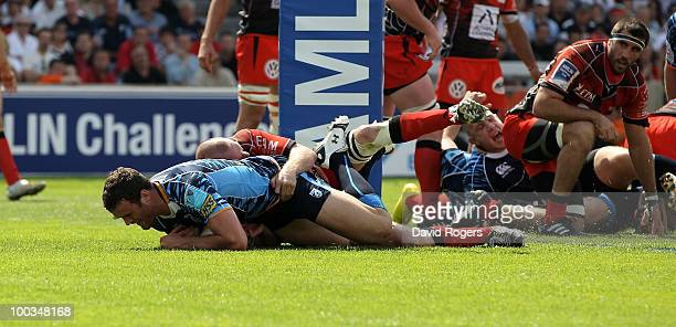 Jamie Roberts of Cardiff dives over to score a try during the Amlin Challenge Cup Final between Toulon and Cardiff Blues at Stade Velodrome on May 23...