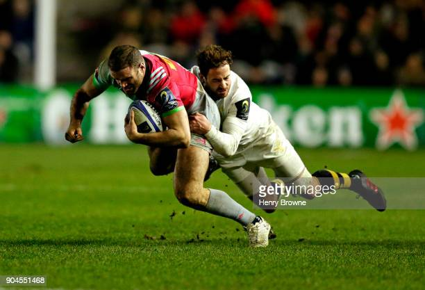 Jamie Roberts of Harlequins and Danny Cipriani of Wasps during the European Rugby Champions Cup match between Harlequins and Wasps at Twickenham...