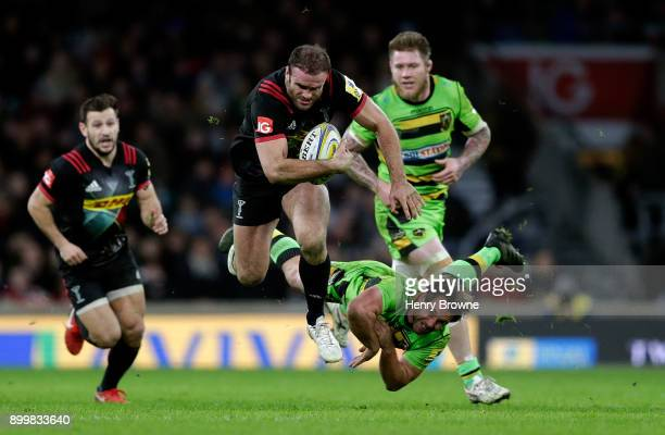 Jamie Roberts of Harlequins is tackled by Nic Groom of Northampton Saints during the Aviva Premiership Big Game 10 match between Harlequins and...