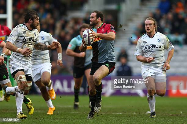 Jamie Roberts of Harlequins makes a break during the European Rugby Challenge Cup pool three match between Harlequins and Cardiff Blues at the...