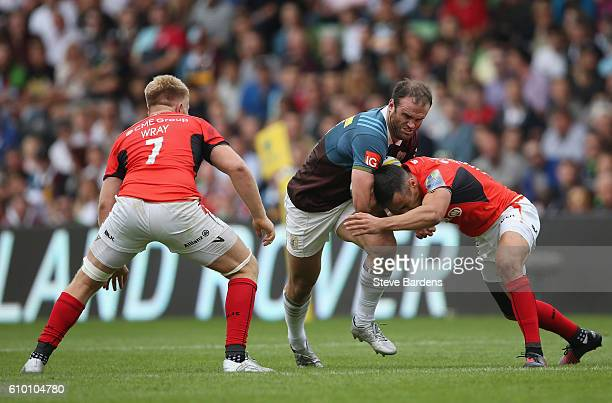 Jamie Roberts of Harlequins takes on the Saracens defence during the Aviva Premiership match between Harlequins and Saracens at Twickenham Stoop on...