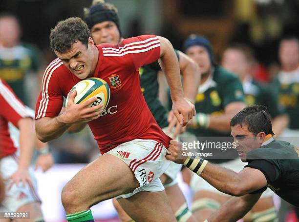 Jamie Roberts of the British and Irish Lions grabbed by Ruan Pienaar of South Africa during the First Test match between the South African Springboks...