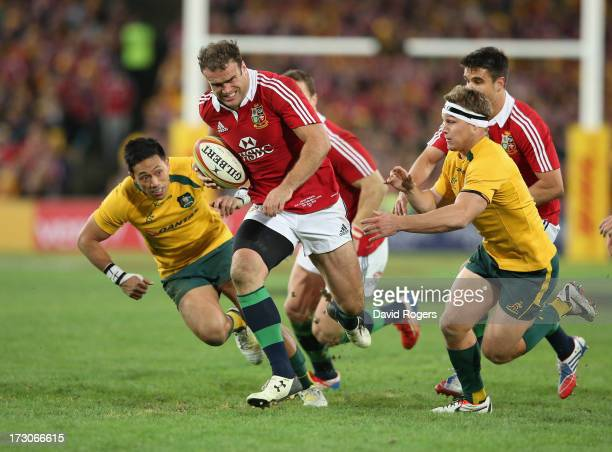 Jamie Roberts of the Lions breaks clear of Christian Leali'ifano and Michael Hooper to score the Lions fourth try during the International Test match...