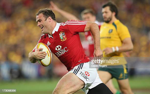 Jamie Roberts of the Lions breaks clear to score the Lions fourth try during the International Test match between the Australian Wallabies and...