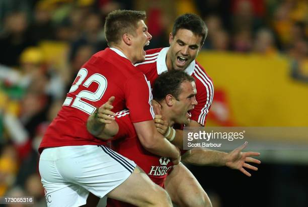 Jamie Roberts of the Lions celebrates after scoring a try during the International Test match between the Australian Wallabies and British Irish...