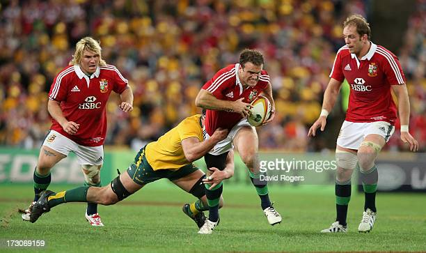 Jamie Roberts of the Lions is tackled during the International Test match between the Australian Wallabies and British Irish Lions at ANZ Stadium on...