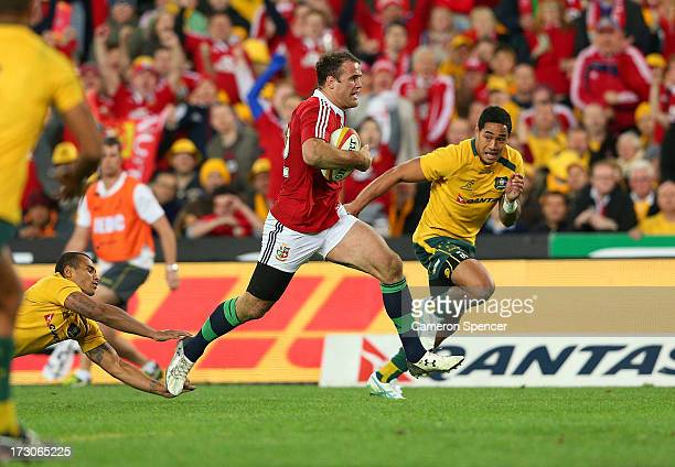 Jamie Roberts of the Lions makes a break to score a try during the International Test match between the Australian Wallabies and British Irish Lions...