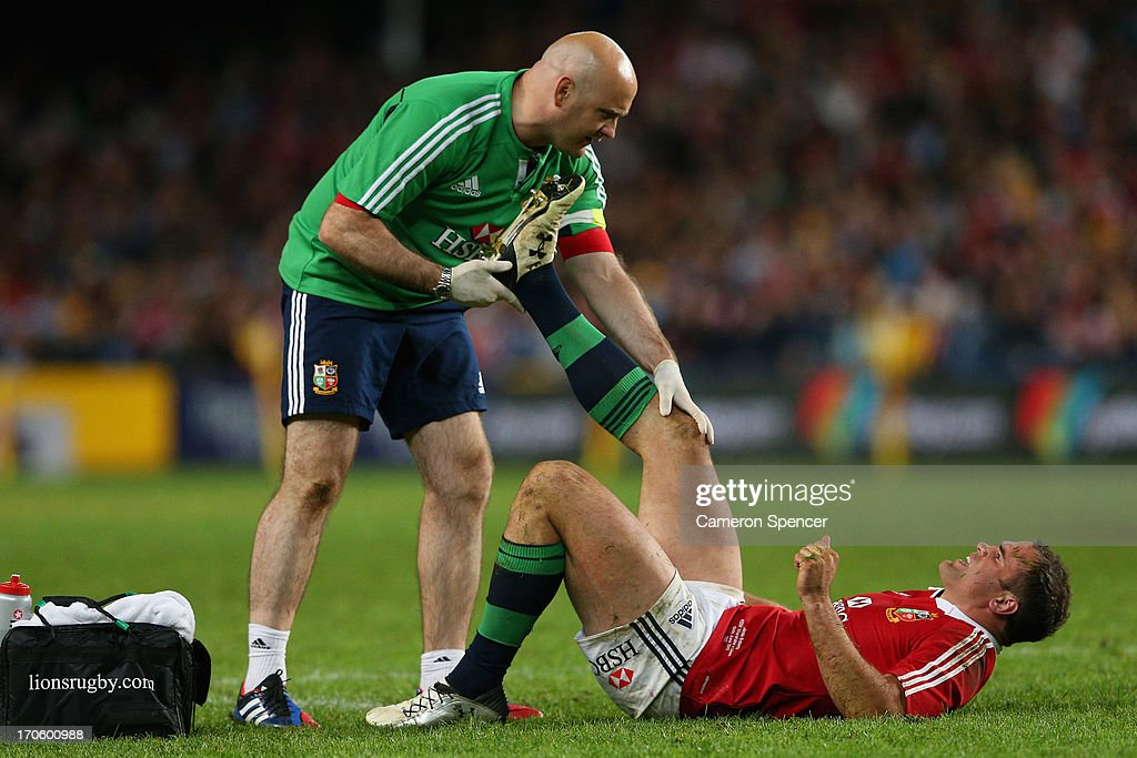 Jamie Roberts of the Lions receives attention after injuring himself during the match between the Waratahs and the British & Irish Lions at Allianz Stadium on June 15, 2013 in Sydney, Australia.