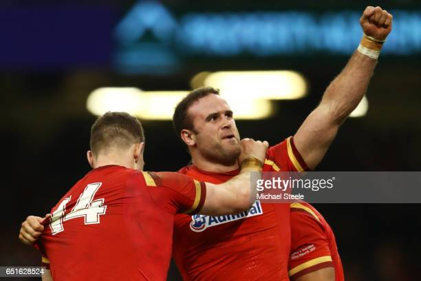 Jamie Roberts of Wales celebrates as he scores their third try with George North during the Six Nations match between Wales and Ireland at the...