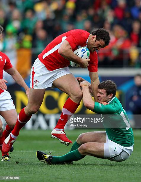 Jamie Roberts of Wales charges over the challenge from Gordon D'Arcy of Ireland during quarter final one of the 2011 IRB Rugby World Cup between...
