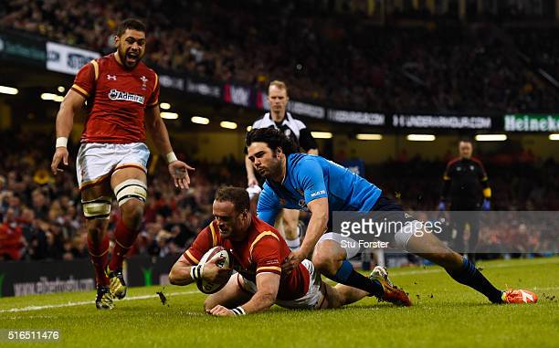 Jamie Roberts of Wales goes past Luke McLean of Italy to score his team's fourth try during the RBS Six Nations match between Wales and Italy at the...