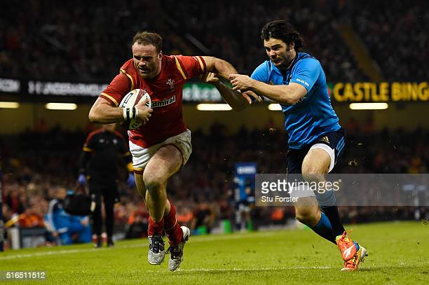 Jamie Roberts of Wales hands off Luke McLean of Italy to score his team's fourth try during the RBS Six Nations match between Wales and Italy at the...