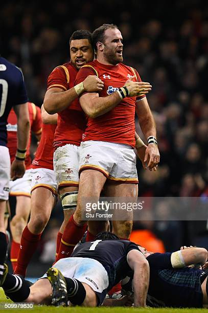 Jamie Roberts of Wales is congratulated by teammate Taulupe Faletau of Wales after scoring his team's second try during the RBS Six Nations match...