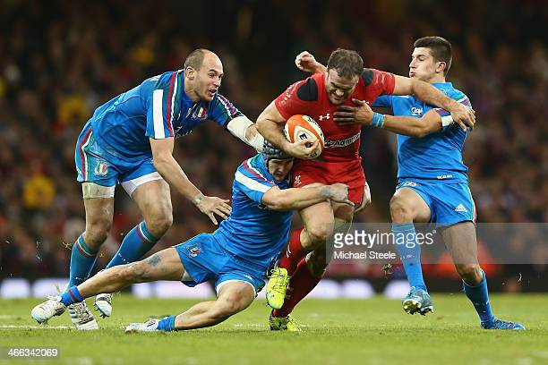 Jamie Roberts of Wales is held up by Tommaso Allan Michele Campagnaro and Sergio Parisse of Italy during the RBS Six Nations match between Wales and...