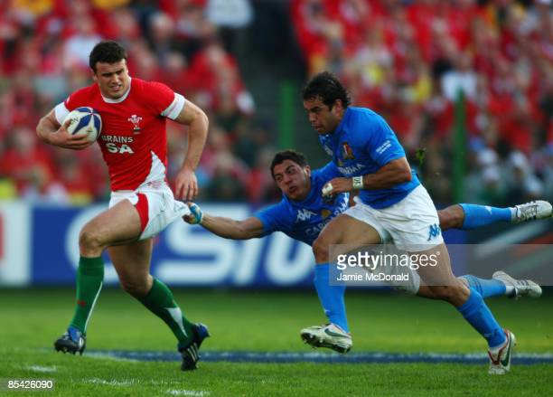 Jamie Roberts of Wales is tackled by Luke McLean of Italy during the RBS 6 Nations Championship match between Italy and Wales at the Stadio Flaminio...