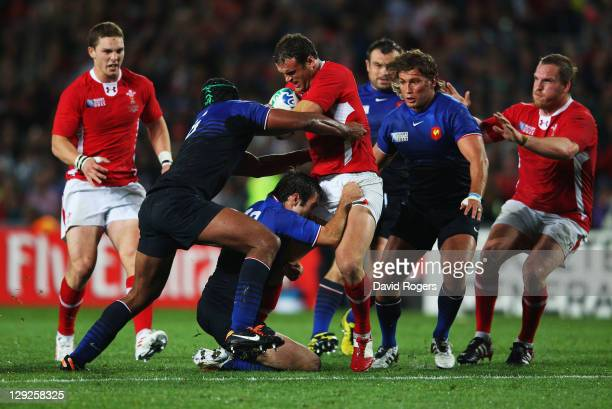 Jamie Roberts of Wales is tackled by Morgan Parra of France during semi final one of the 2011 IRB Rugby World Cup between Wales and France at Eden...