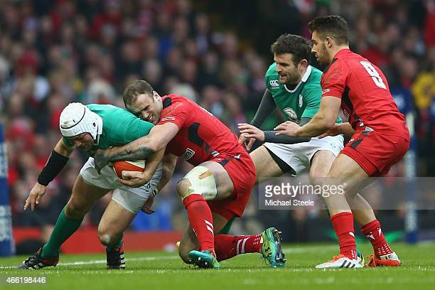 Jamie Roberts of Wales tackles Rory Best of Ireland during the RBS Six Nations match between Wales and Ireland at the Millennium Stadium on March 14...