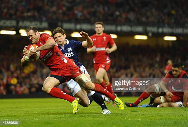 Jamie Roberts of Wlaes scores a try under pressure from Ross Ford of Scotland during the RBS Six Nations match between Wales and Scotland at...