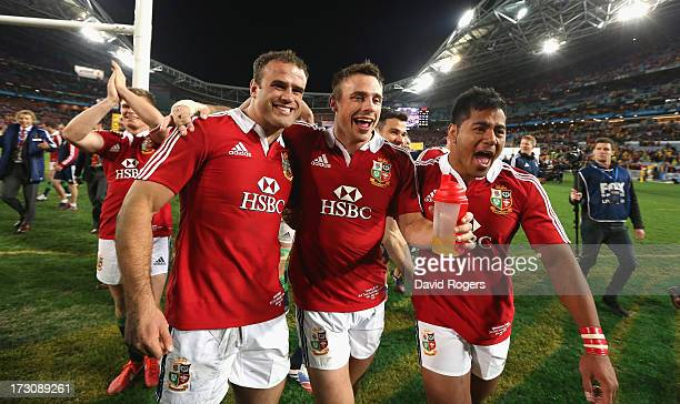 Jamie Roberts Tommy Bowe and Manu Tuilagi of the Lions celebrates after their victory during the International Test match between the Australian...