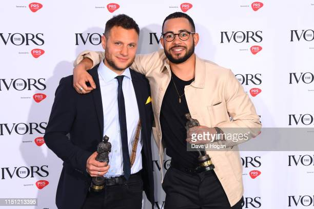 Jamie Scott and Dan Chaplen win the Ivor Novello PRS for Music Most Performed Work pose in the winners room at The Ivors 2019 at Grosvenor House on...