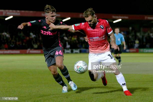 Jamie Shackleton of Leeds United and Danny LloydMcGoldrick of Salford City compete for the ball during the Carabao Cup First Round match between...