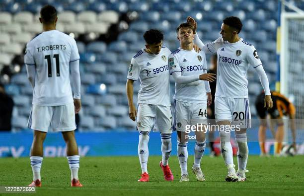 Jamie Shackleton of Leeds United is consoled by teammates Ian Poveda-Ocampo and Rodrigo Moreno of Leeds United after he misses a crucial penalty in a...