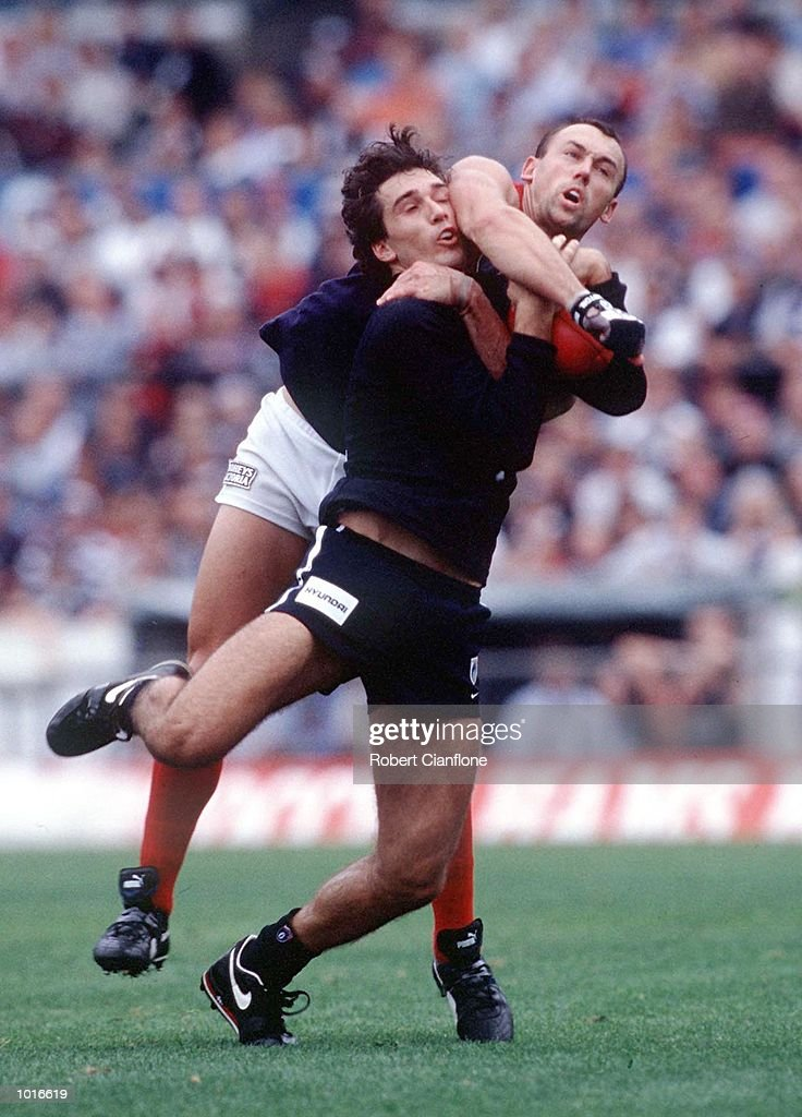 Jamie Shanahan of Melbourne comes from behind to spoil Stephen Silvagni of Carlton, in the match between Carlton and Melbourne, during round four of the AFL season, played at the Melbourne Cricket Ground, Melbourne, Australia. Mandatory Credit: Robert Cianflone/ALLSPORT