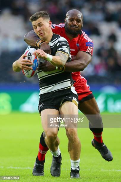 Jamie Shaul of Hull FC is tackled by Robert Lui of Salford Red Devils during the Betfred Super League match between Hull FC and Salford Red Devils at...