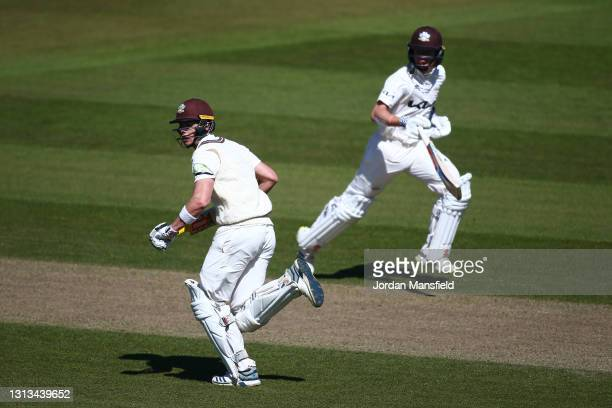 Jamie Smith and Ollie Pope of Surrey run between the wickets during day three of the LV= Insurance County Championship match between Surrey and...