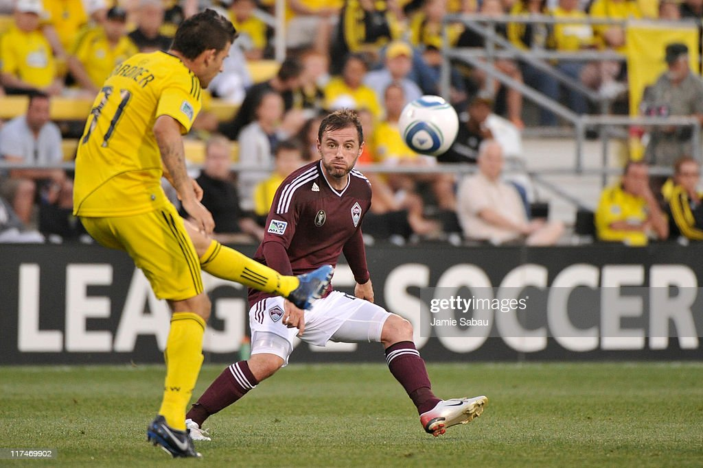 Jamie Smith #20 of the Colorado Rapids defends against Josh Gardner #31 of the Columbus Crew on June 26, 2011 at Crew Stadium in Columbus, Ohio. Columbus defeated Colorado 4-1.