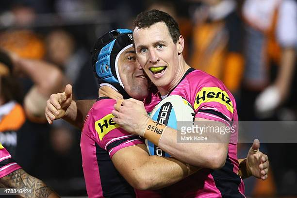 Jamie Soward and David Simmons of the Panthers celebrate after Simmons scored a try during the round 16 NRL match between the Wests Tigers and the...