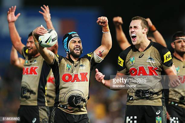 Jamie Soward and Isaah Yeo of the Panthers celebrate after team mate Bryce Cartwright scores the winning try during the round five NRL match between...