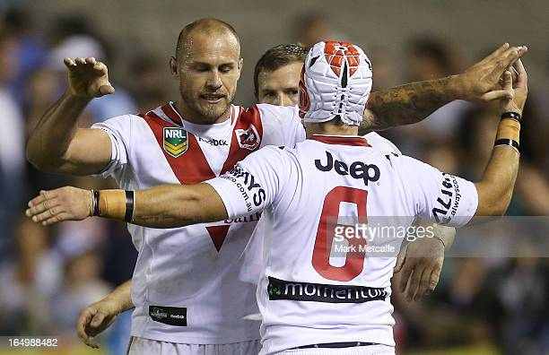 Jamie Soward and Matt Cooper of the Dragons celebrate victory during the round four NRL match between the Cronulla Sharks and the St George Illawarra...