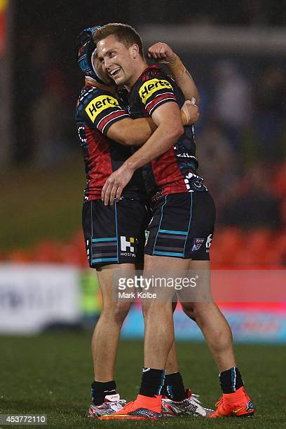 Jamie Soward and Matt Moylan of the Panthers celebrate the Panthers 2322 victory during the round 23 NRL match between the Penrith Panthers and the...