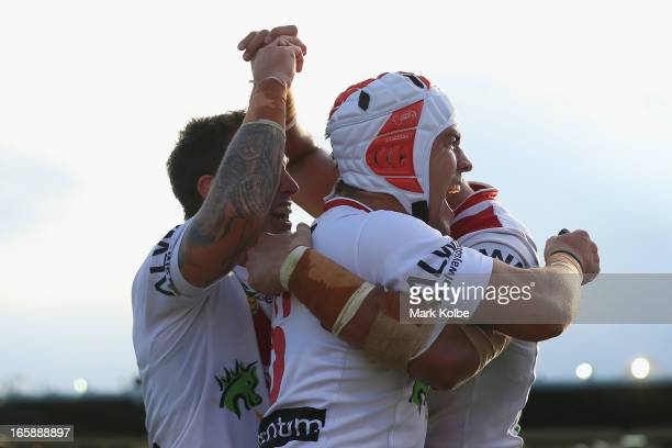 Jamie Soward and Nathan Fien of the Dragons celebrate after Jason Nightingale of the Dragons scored a try during the round five NRL match between the...
