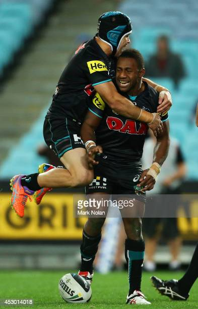 Jamie Soward of the Panthers and James Segeyaro of the Panthers celebrate Segeyaros try during the round 21 NRL match between the Canterbury Bulldogs...