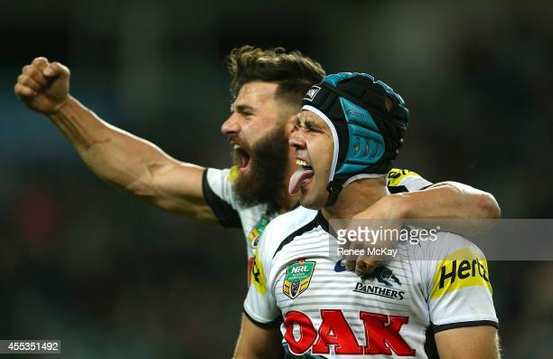 Jamie Soward of the Panthers celebrates his teams win with Josh Mansour during the NRL 1st Qualifying Final match between the Sydney Roosters and the...