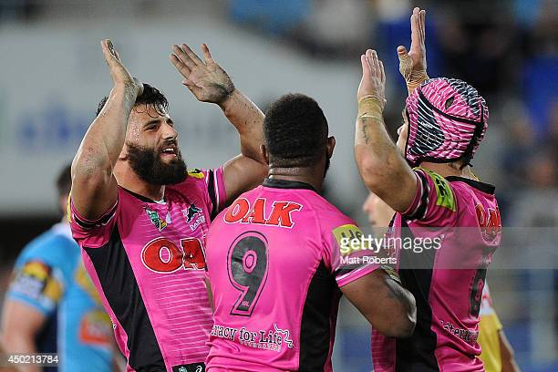 Jamie Soward of the Panthers celebrates scoring a try with teammates during the round 13 NRL match between the Gold Coast Titans and the Penrith...