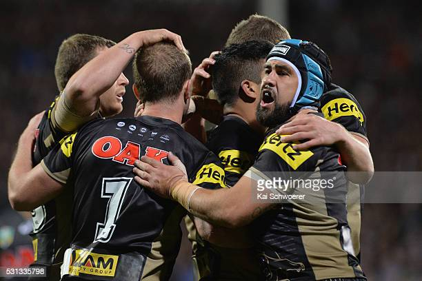 Jamie Soward of the Panthers celebrates with team mates after Tyrone Peachey scored a try during the round 10 NRL match between the Penrith Panthers...
