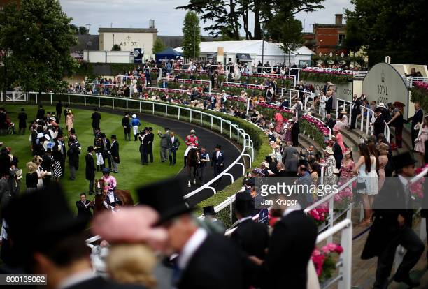 Jamie Spencer mounts his horse Visionary in the parade ring on day 4 of Royal Ascot at Ascot Racecourse on June 23 2017 in Ascot England