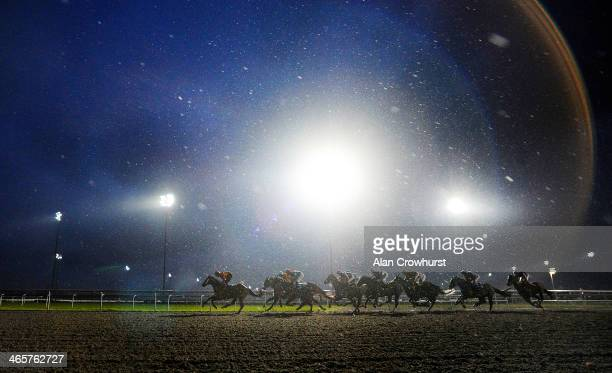Jamie Spencer riding Bapak Pesta lead all the way to win The kemptoncouk Handicap Stakes in heavey rain at Kempton Park racecourse on January 29 2014...