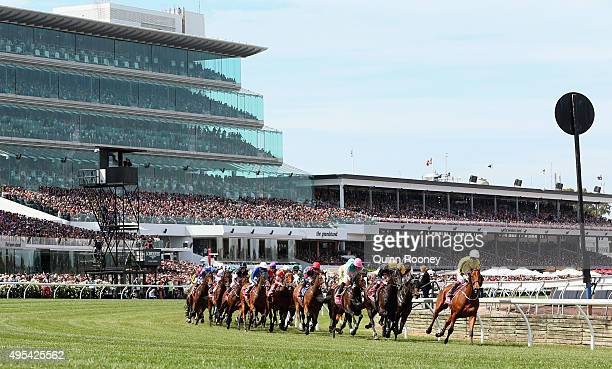 Jamie Spencer riding Big Orange leads the field around the first bend in race 7 the Emirates Melbourne Cup on Melbourne Cup Day at Flemington...