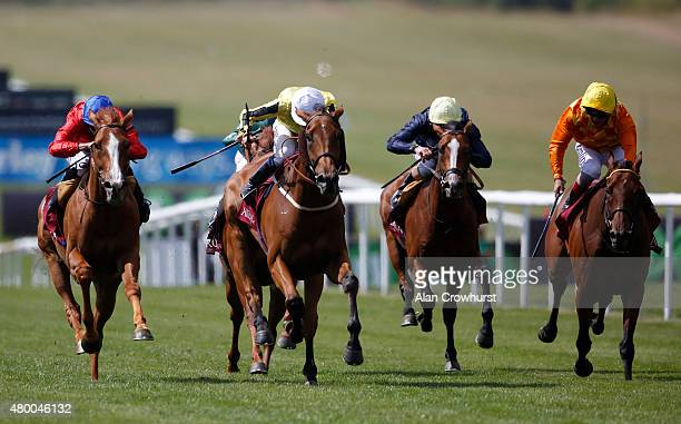 Jamie Spencer riding Big Orange win The Princess Of Wales's Arqana Racing Club Stakes at Newmarket racecourse on July 09 2015 in Newmarket England