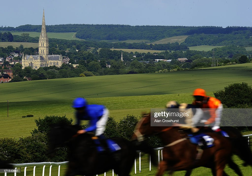 Jamie Spencer riding Cafe Society (R, orange) on their way to winning The Ashbrittle Stud Bibury Cup Stakes at Salisbury racecourse on June 26, 2013 in Salisbury, England.