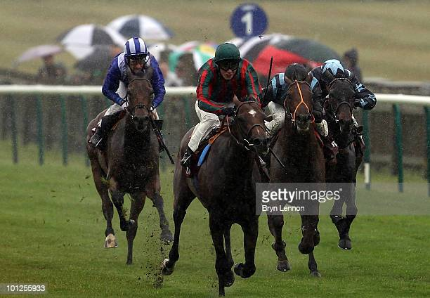 Jamie Spencer riding Green Moon leads The Novae Bloodstock Insurance Fairway Stakes at The Newmarket Rowley Mile Racecourse on May 29 2010 in...