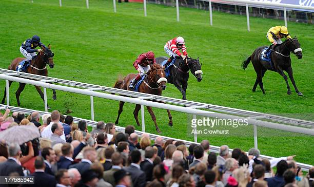 Jamie Spencer riding Hot Streak win The Julia Graves Roses Stakes at York racecourse on August 24 2013 in York England