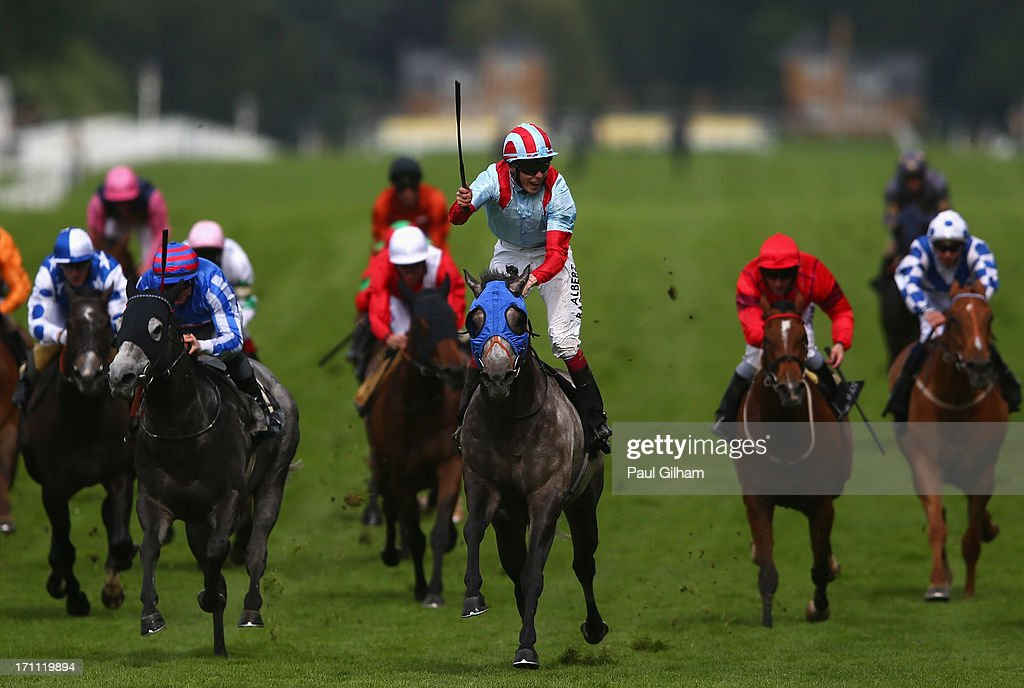 Jamie Spencer riding on York Glory celebrates as he crosses the finish line to win The Wokingham Stakes during day five of Royal Ascot at Ascot Racecourse on June 22, 2013 in Ascot, England.